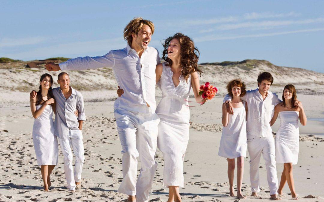 white color for beach wedding attire, people celebrating beach wedding