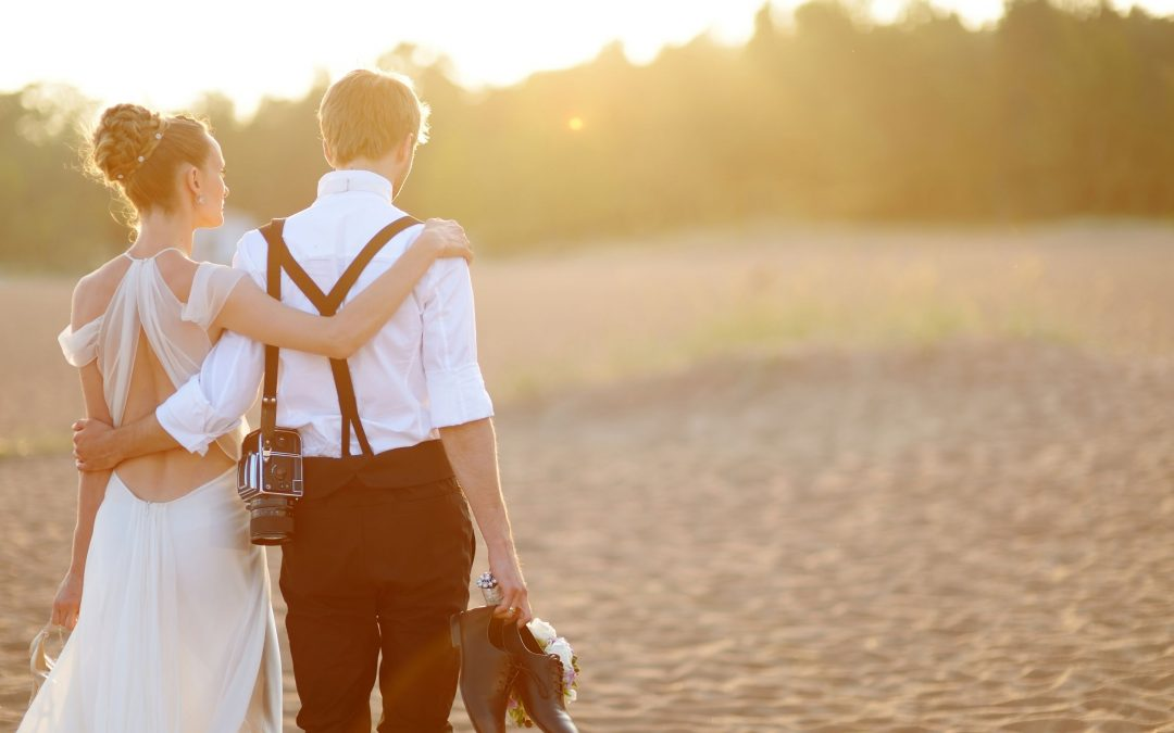couple enjoying of a beach wedding (one of the most popular wedding trends)